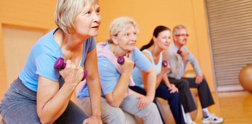 senior people doing back training exercises